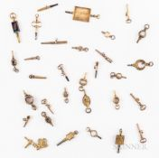 Thirty-one Gilt Watch Keys, 19th/20th century, engraved, chased, and embossed examples.