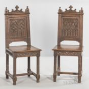 Six Gothic-style Oak Side Chairs, late 19th/early 20th century, each with a paneled back carved with