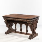 Carved Oak Library Table, late 19th/early 20th century, with figural caryatid trestle supports joine