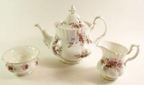 A Royal Albert Lavender Rose tea service comprising teapot, milk, sugar, cake plate, six cups