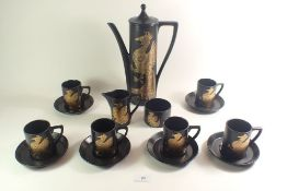 A Portmeirion Phoenix coffee set comprising coffee pot, milk, sugar and six cups and saucers