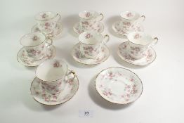 A set of seven Paragon 'Victorious Rose' cups and saucers