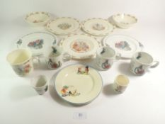 A collection of nursery china comprising two Wedgwood Peter Rabbit plates and four mugs, three