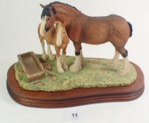 A Border Fine Arts model of a Mare and Foal with trough 'Spring Pastures'.