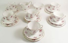 A Queen Anne vintage tea service comprising: six cups and saucers, six tea plates, jug and sugar