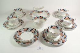 An Edwardian Bridgwood tea service, 'Hawthorn', comprising: five cups and saucers, six tea plates,
