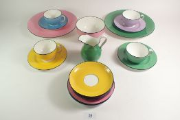 A Minton harlequin part tea service comprising: four cups and saucers, five tea plates, two cake