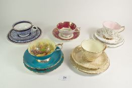 Five various cups and saucers including Royal Worcester