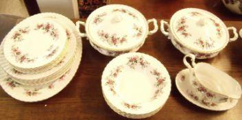 A Royal Albert Lavender Rose dinner service comprising meat plate, six dinner plates, gravy boat,