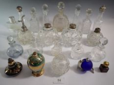 A large collection of cut glass perfume or scent bottles