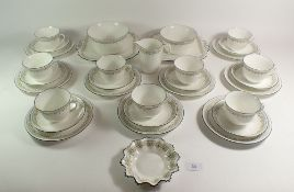 A 1920's Shelley porcelain tea set in the Bell pattern (no. 11233), comprising 9 trios, 2 cake
