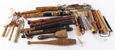 A box of various priests, batons, truncheons, coshes, and marrow spoons, etc