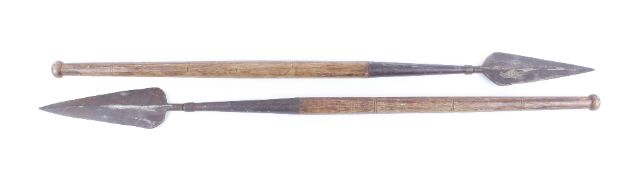 Two African spade pointed spears with short wooden shafts