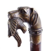 Walking cane with brass game dog and bird handle