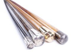 Four walking canes: one with silver pommel and three similar canes