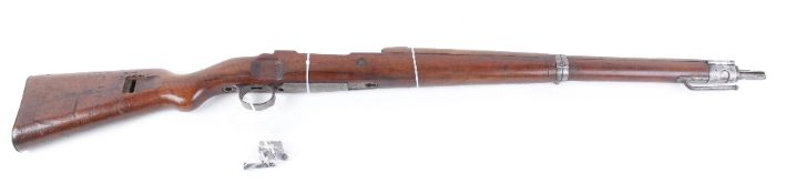 The wood and metal work of a Mauser K98 1915 bolt action military rifle