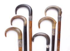 Six tapered crook handled walking sticks