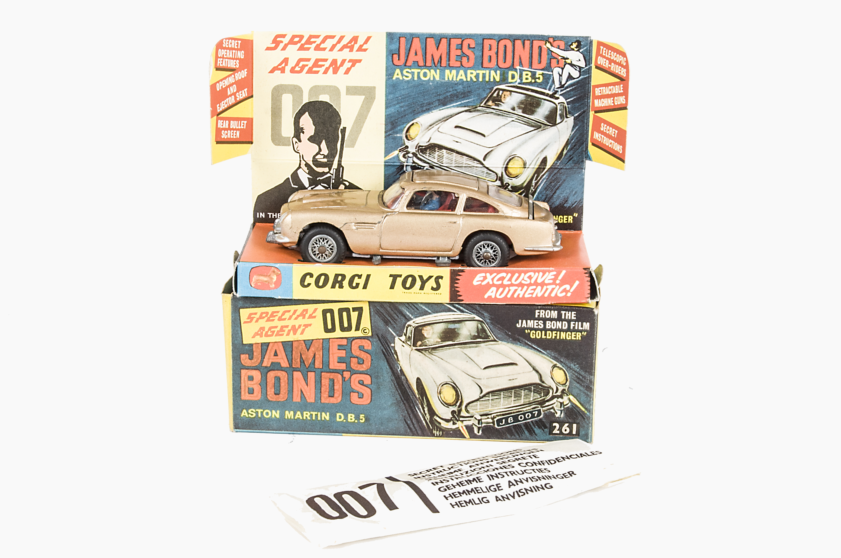 Lot 260 - A Corgi Toys 261 James Bond's Aston Martin D.B.5, gold body, red interior, wire wheels, Bandit