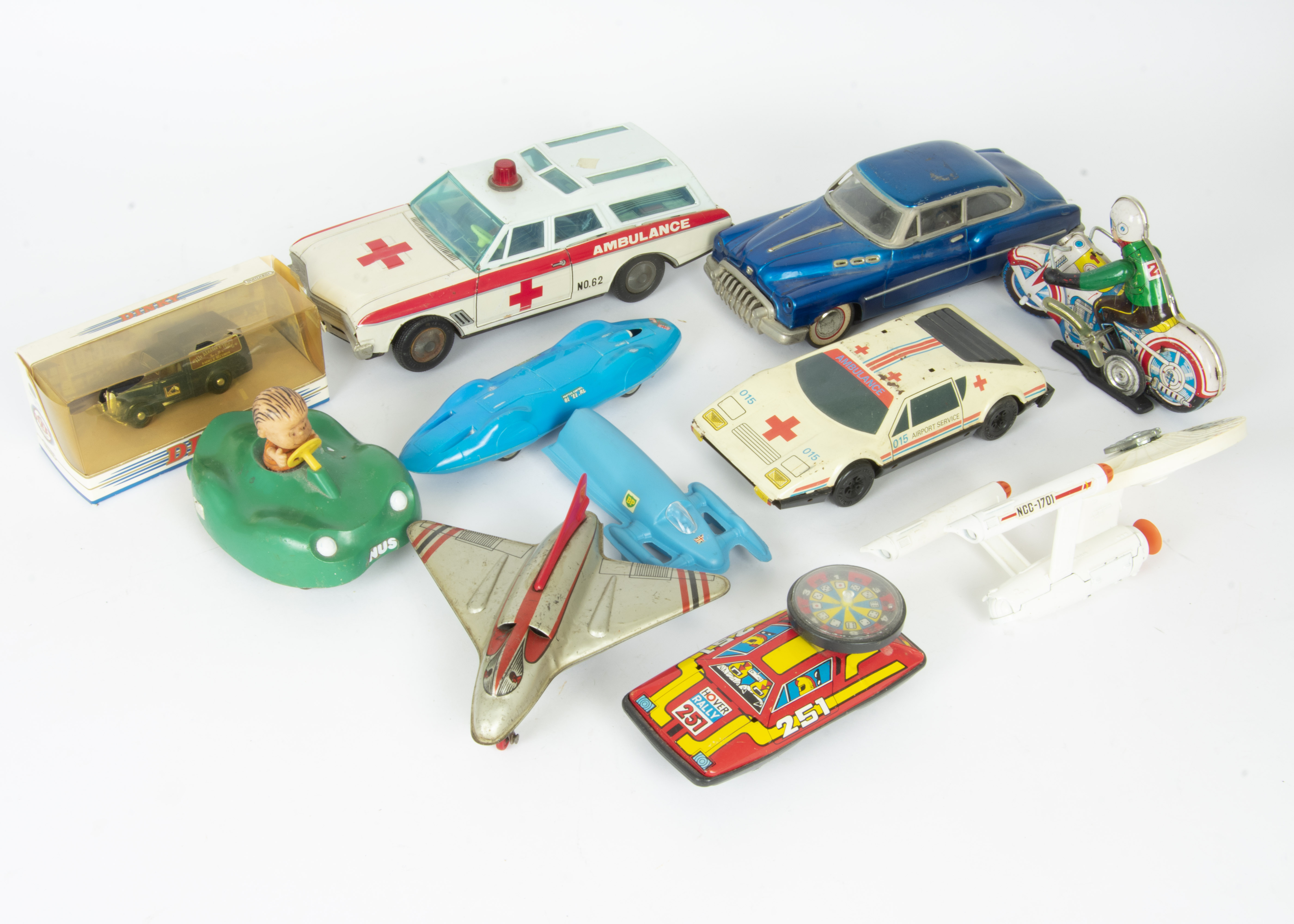 Lot 220 - Jetex Bluebird various Tin Cars and other Toys, Jetex BP Bluebird Set with speedboat and BP book