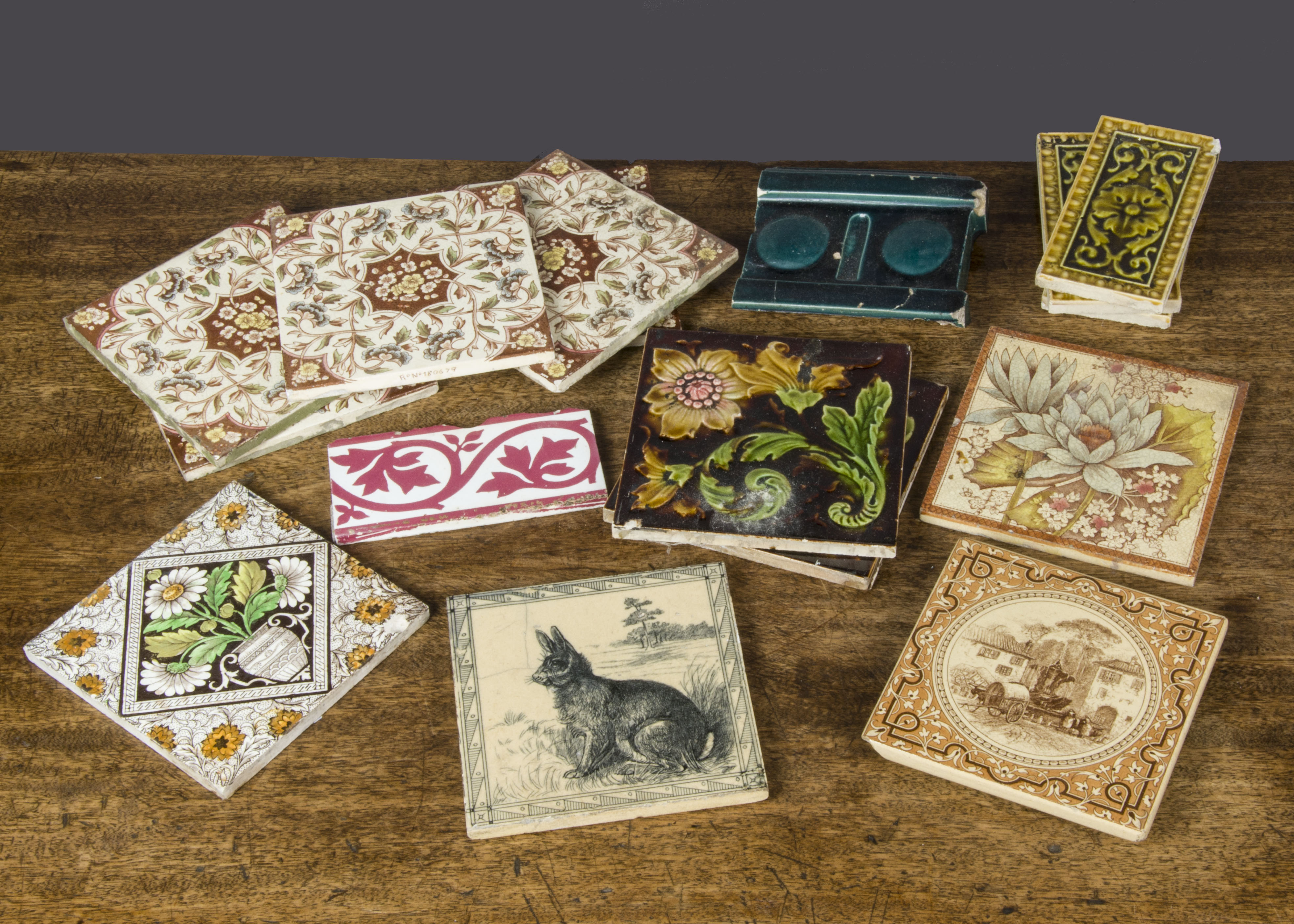 Lot 578 - English pottery tiles, a Minton black transfer printed with a hare (crack); a Minton tile trivet