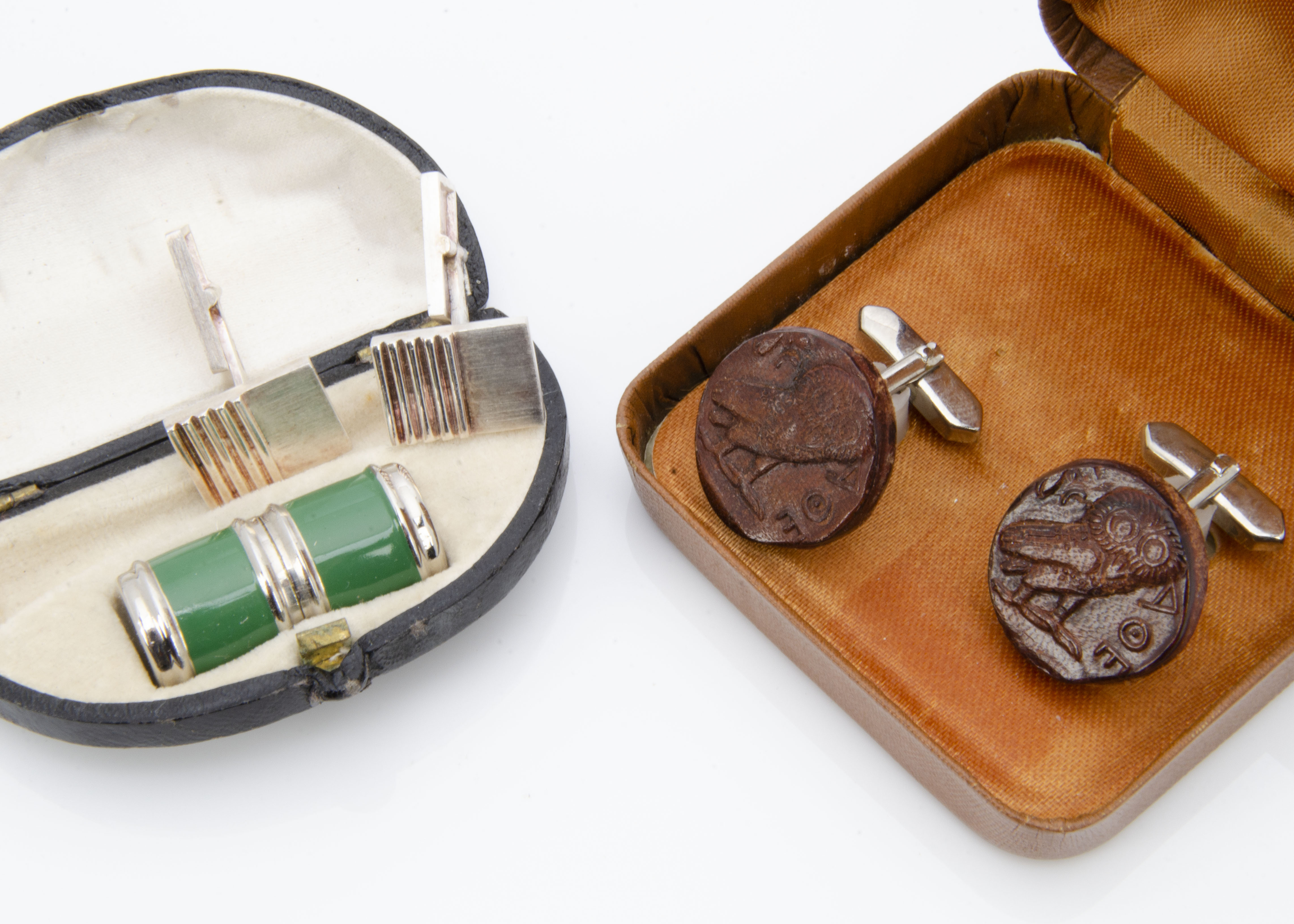 Lot 252 - A pair of silver contemporary cufflinks, a pair of leather and chromed stainless steel cufflinks and