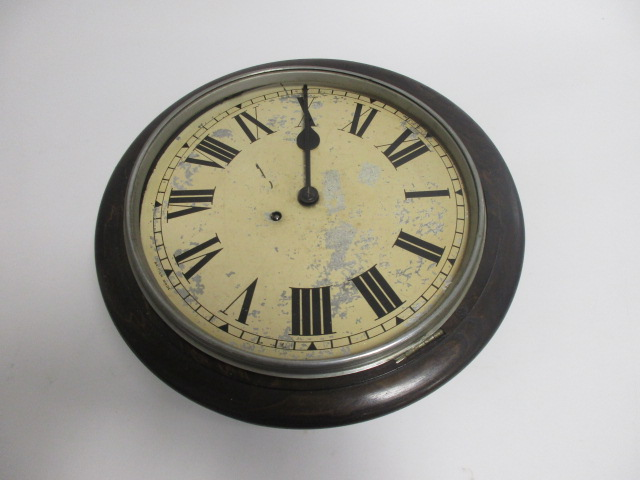 Lot 158 - A Mid 20th Century drop dial wall clock, the enamel dial with Roman numerals and marked 'British
