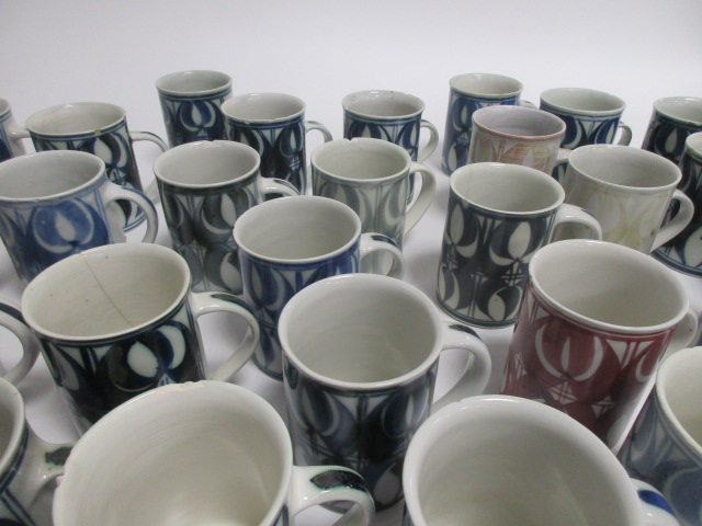 Lot 4 - A collection of Aldermaston pottery cups, thirty two signed by Jenny Jowett and one by Alan Caiger-