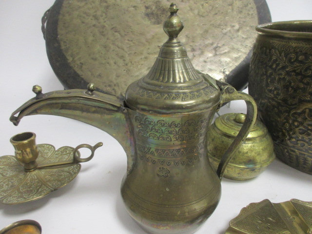 Lot 199 - A small group of Middle Eastern and Asian brasswares including a gong, diameter 49cm and a large