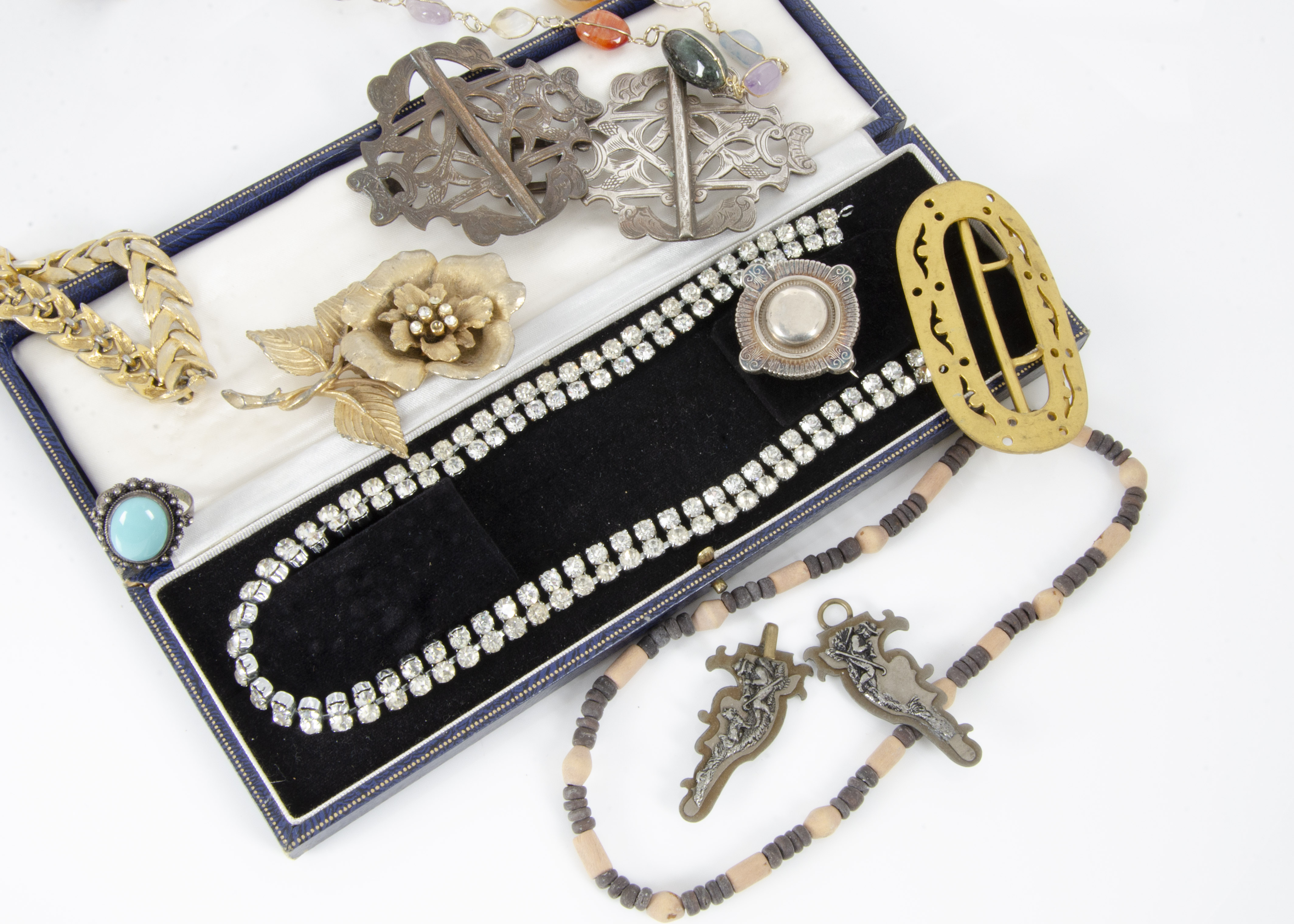 Lot 265 - A collection of costume jewellery including a Victorian silver brooch, a simulated turquoise ring,