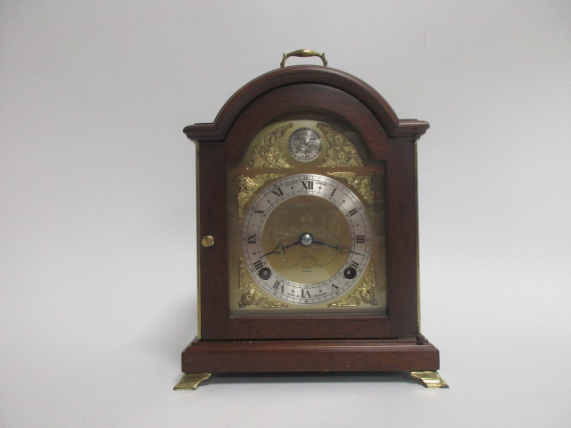 Lot 114 - An 18th Century style mahogany cased bracket clock by Elliott, the arched brass dial with a '