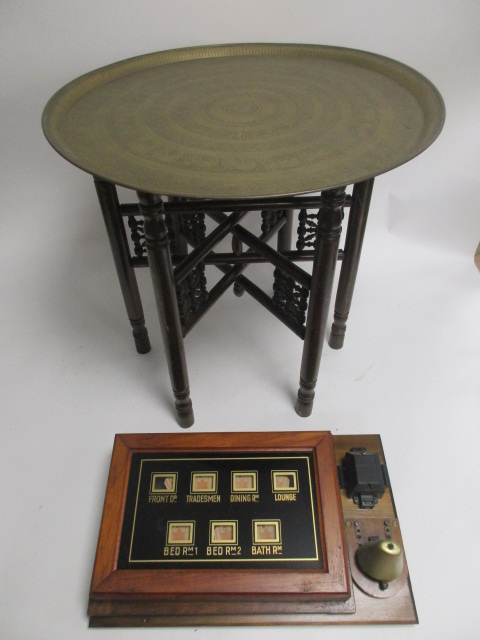 Lot 65 - A table with Middle Eastern brass top, with various foliate, animal and script borders, diameter