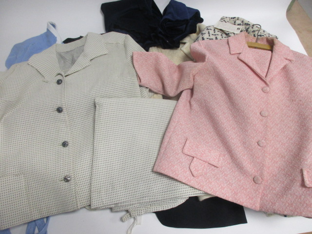 Lot 23 - A collection of ladies vintage two-piece suits, including a pink jacket and skirt by Crimplene, a