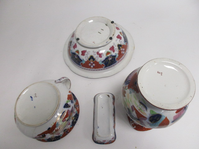 Lot 80 - A 19th Century Imari pattern ironstone toilet set, consisting of a jug, height 33cm, large washbowl,