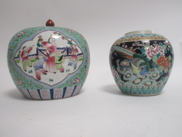 Lot 205 - A 20th Century polychrome enamel covered jar, with upper ruyi border, lower lotus panels and