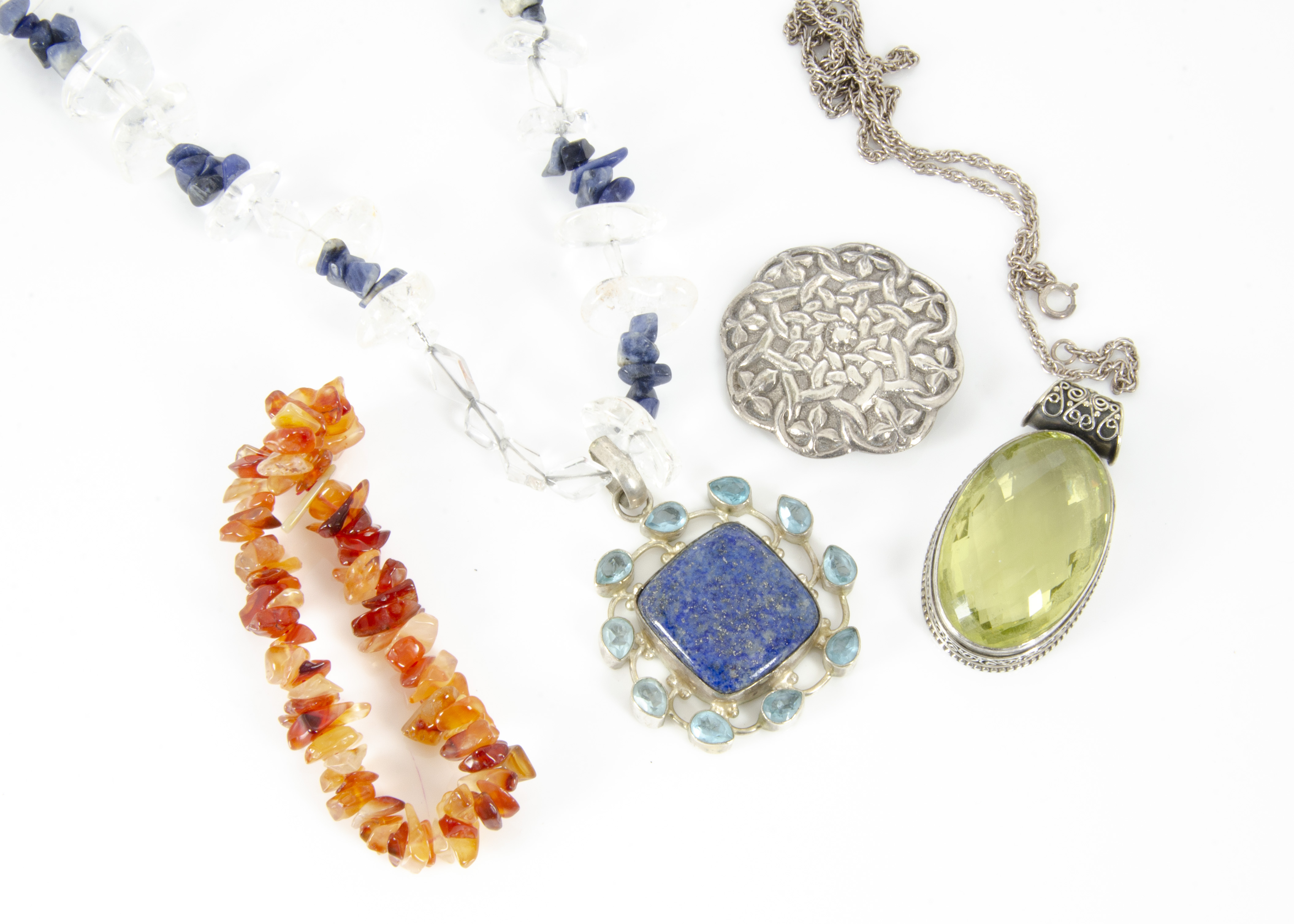 Lot 254 - A collection of various costume jewels, including a silver brooch, a lapis lazuli, rock crystal