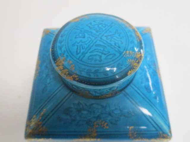 Lot 91 - A 19th Century Continental tea canister, with turquoise glaze and gilt heightening, with impressed