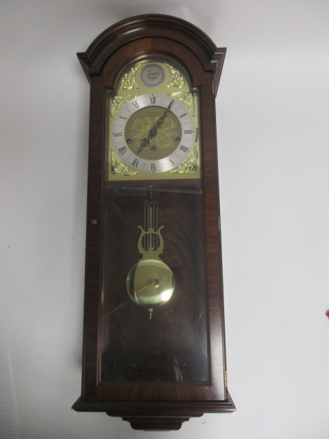 Lot 115 - A mahogany cased chiming wall clock by Comitti, the arched brass dial with a 'Tempus Fugit' plaque