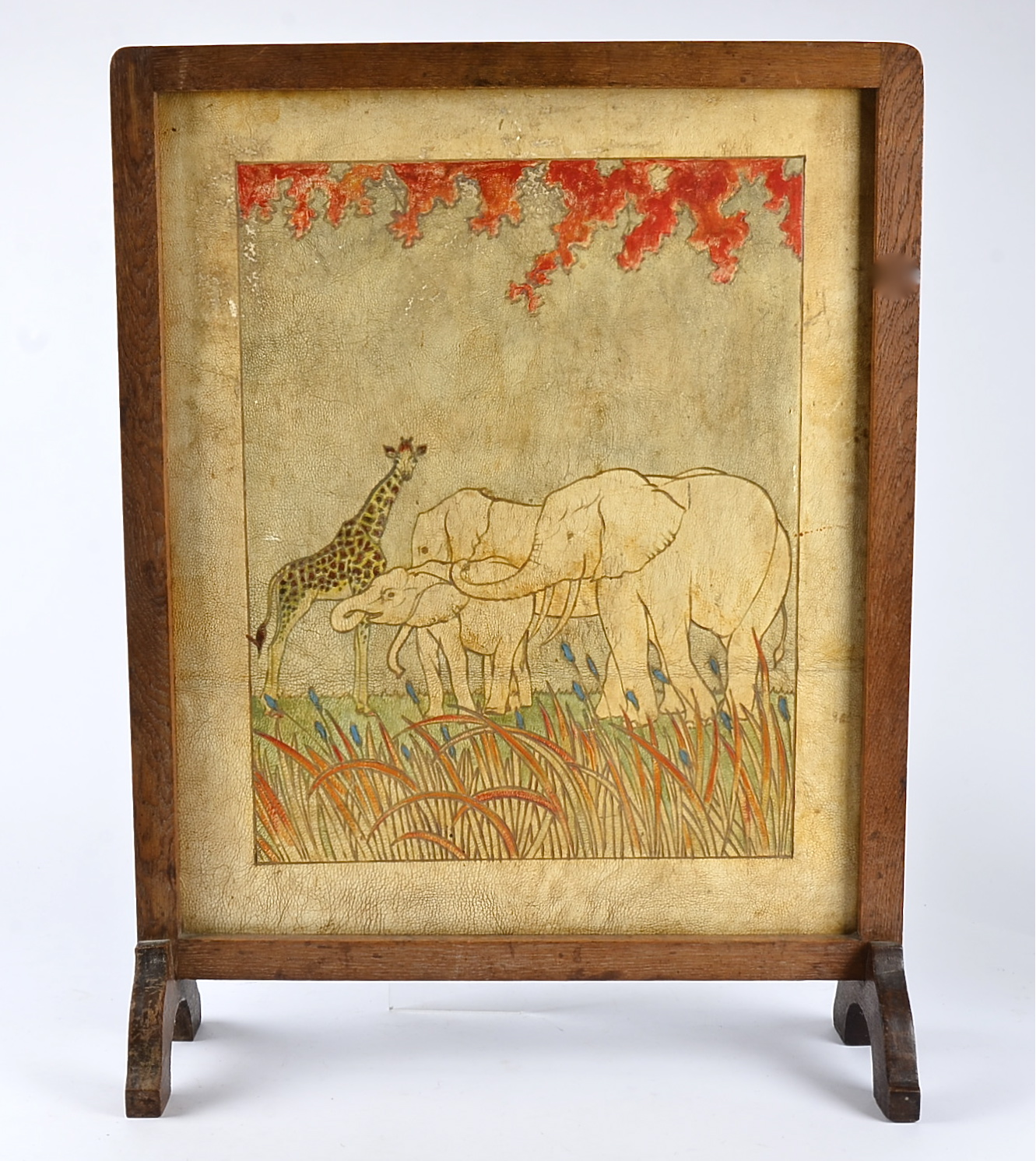 Lot 77 - An early 20th Century fire screen, with a depiction of elephants and a giraffe, together with a