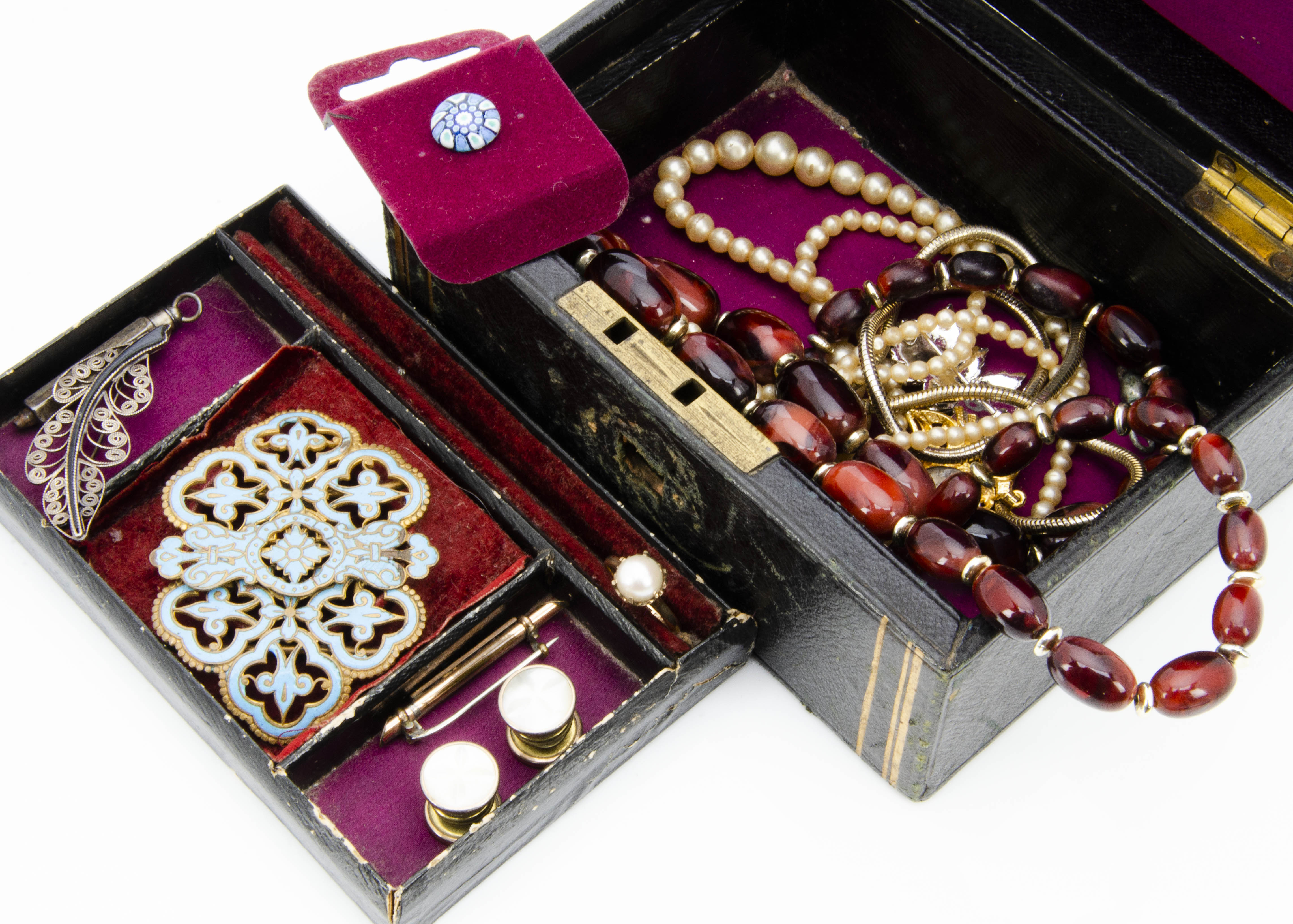 Lot 259 - A 19th Century leather jewellery box, with a base metal and enamel belt buckle, various simulated