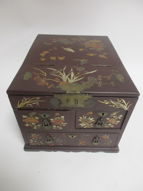 Lot 213 - A Meiji period scarlet ground dressing table box decorated with birds and butterflies, the lid