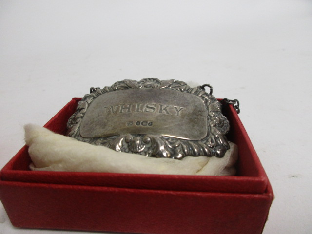 Lot 25 - Three 20th Century hallmarked silver drink decanter labels, Sherry', 'Whisky' and 'Brandy', together