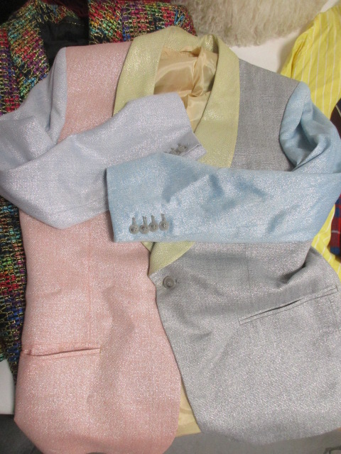 Lot 131 - A collection of novelty clothing, including two metallic jackets, a pair of tartan trousers, five