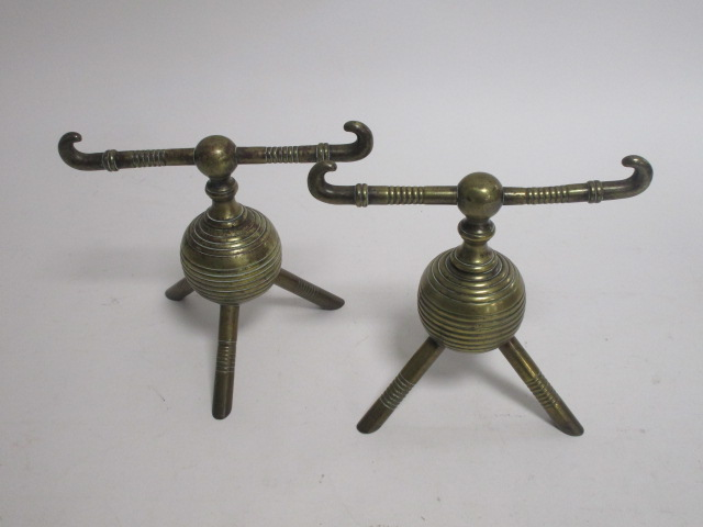 Lot 148 - Manner of Christopher Dresser (1834-1904), a pair of late 19th Century brass andirons, considered to
