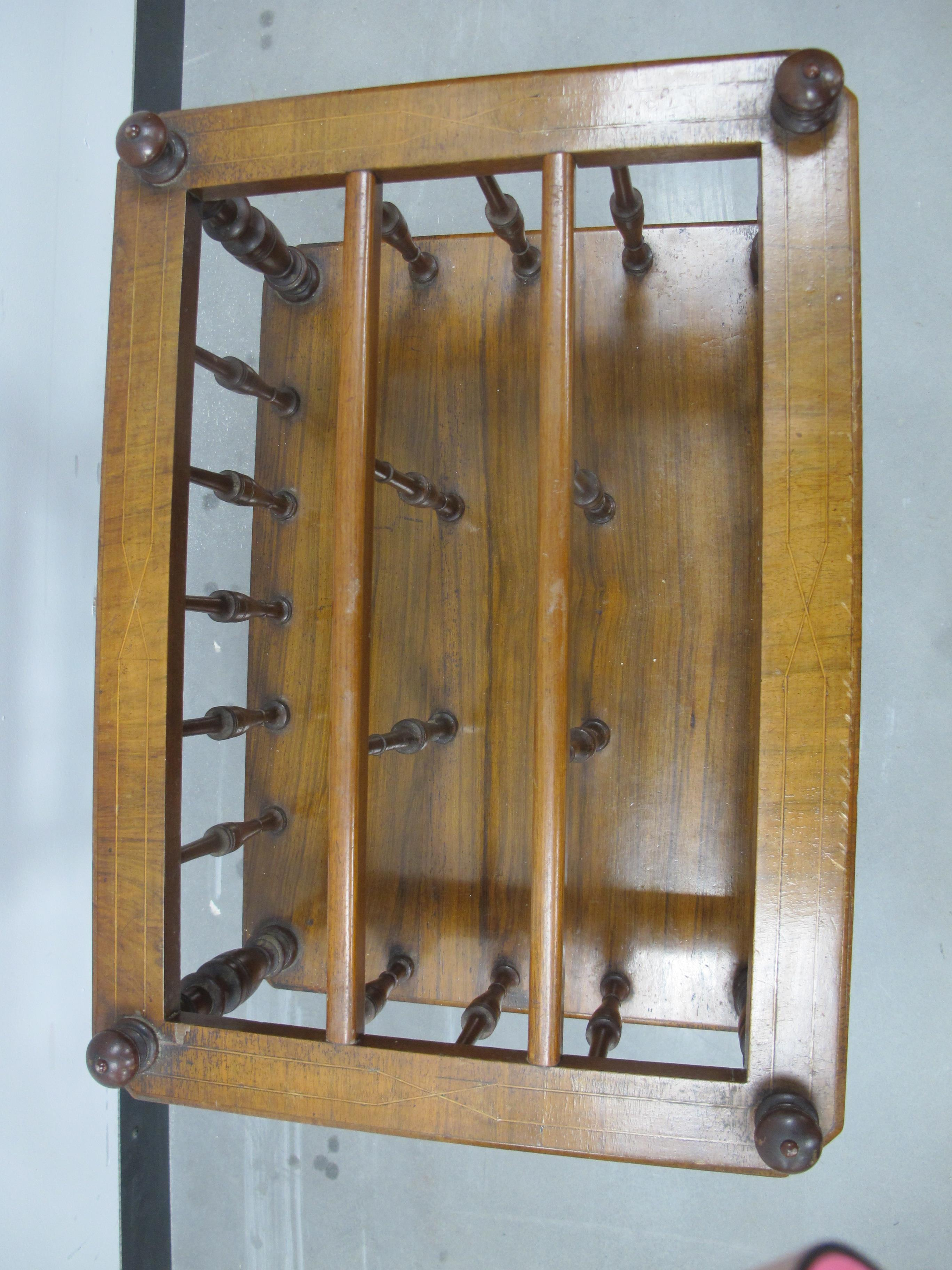 Lot 451 - A 19th Century walnut Canterbury, with one long drawer with boxwood stringing, turned columns and