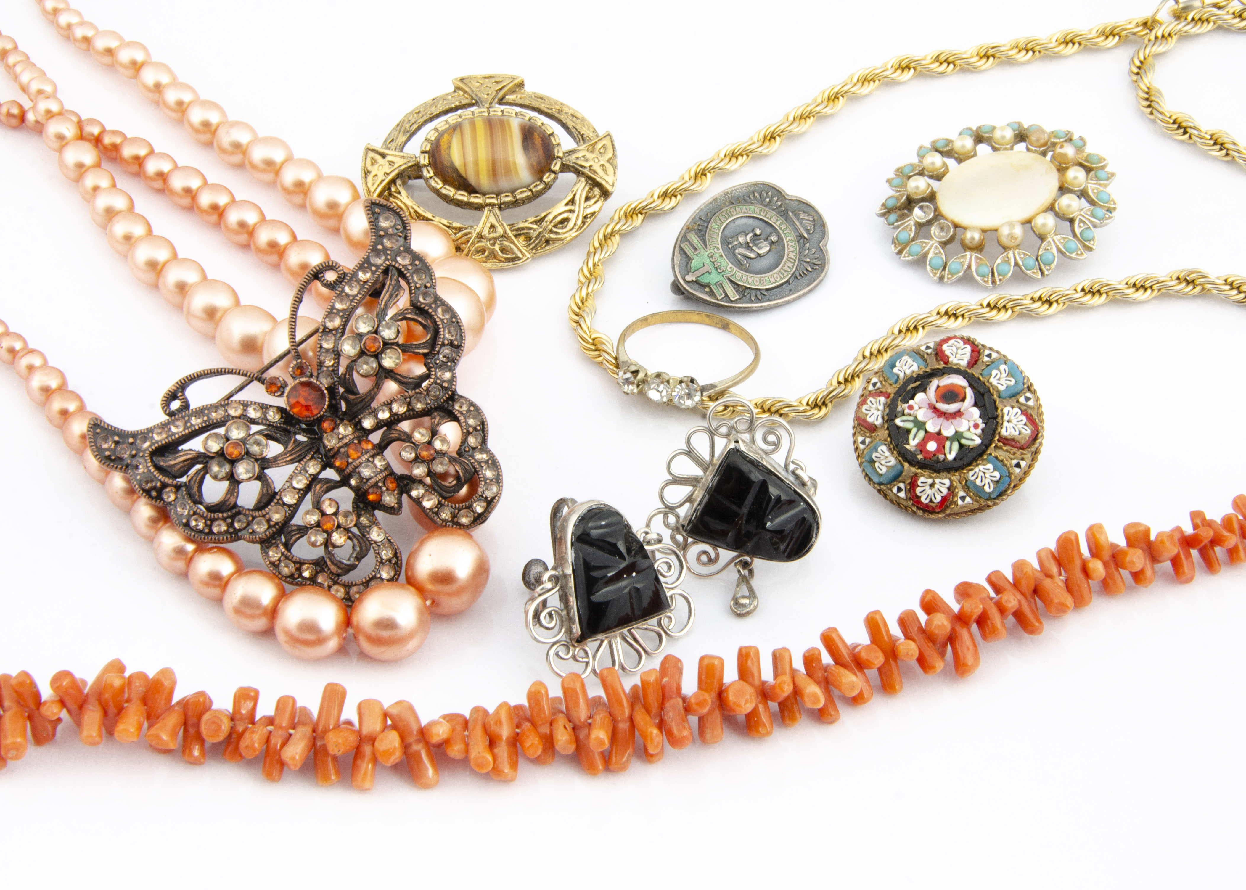 Lot 263 - A quantity of costume jewellery, including simulated beads, silver screw back earrings, a nursery