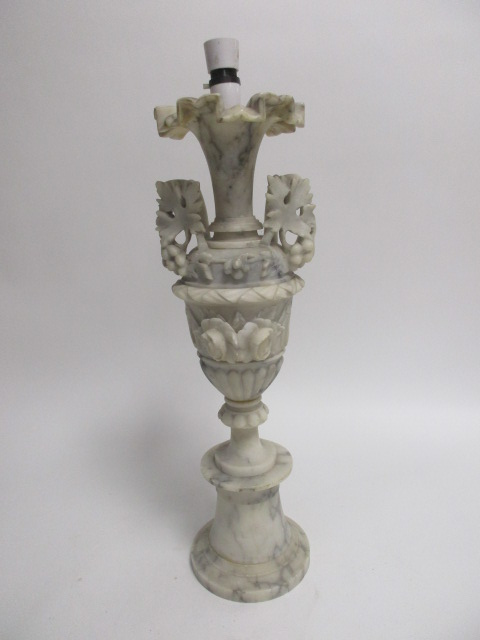 Lot 12 - A 20th Century marble lamp base, modelled as a twin-handled urn with fluted edges upon a circular
