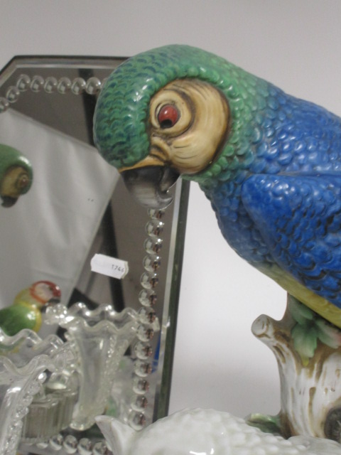 Lot 168 - A small group of Continental glass and ceramics, including a pair of parrots, a blanc de chine