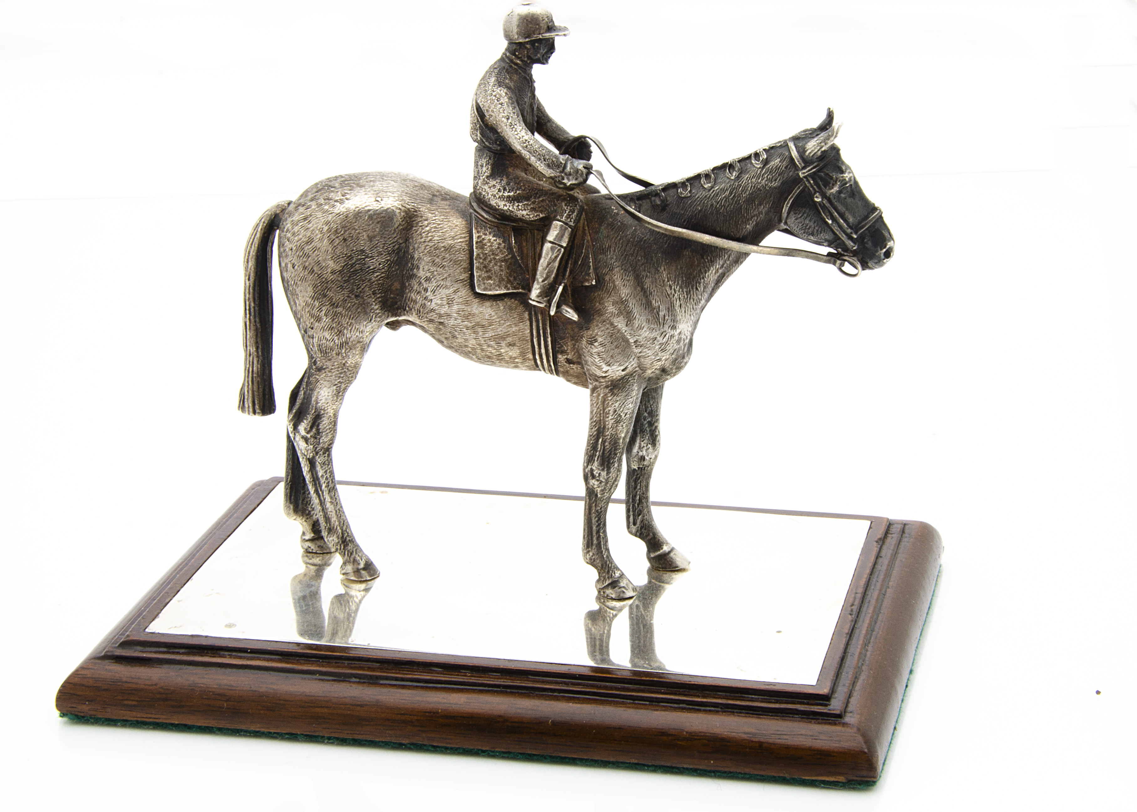 Lot 413 - A 1990s silver horseracing desk ornament by W&W, naturalistically modelled stood with a jockey on