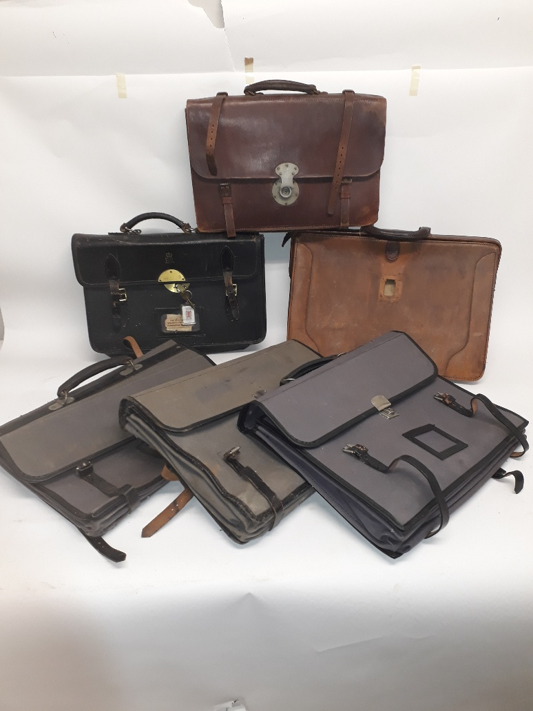 Lot 182 - 1930s and Later Leather and Canvas Brief Cases, two brown leather examples (both in need of repair),