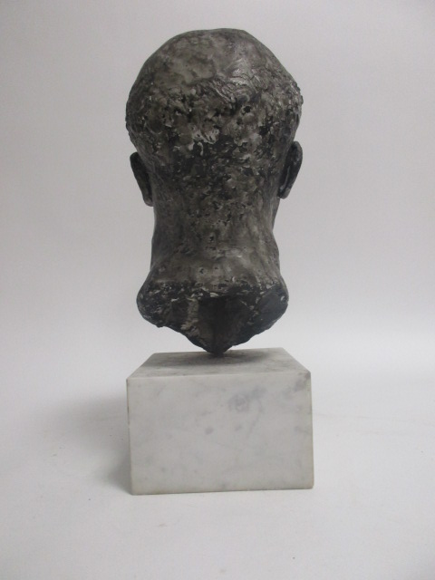Lot 14 - A contemporary composite bust of a man, with black and grey metal alloy glaze, on a square white